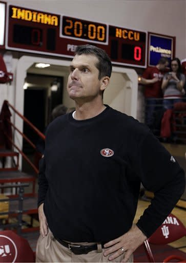 San Francisco 49ers NFL football head coach Jim Harbaugh waits for the start of an NCAA college basketball game between Indiana and North Carolina Central in Bloomington, Ind., Wednesday, Feb. 22, 2012. Harbaugh is the brother-in-law of Indiana head coach Tom Crean. (AP Photo/Michael Conroy)