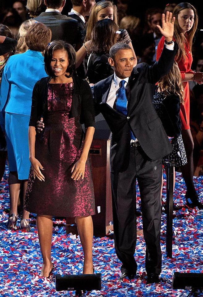 CHICAGO, IL - NOVEMBER 06:  U.S. President Barack Obama stands on stage with first lady Michelle Obama after his victory speech on election night at McCormick Place on November 6, 2012 in Chicago, Illinois.  (Photo by Lyle A. Waisman/WireImage)