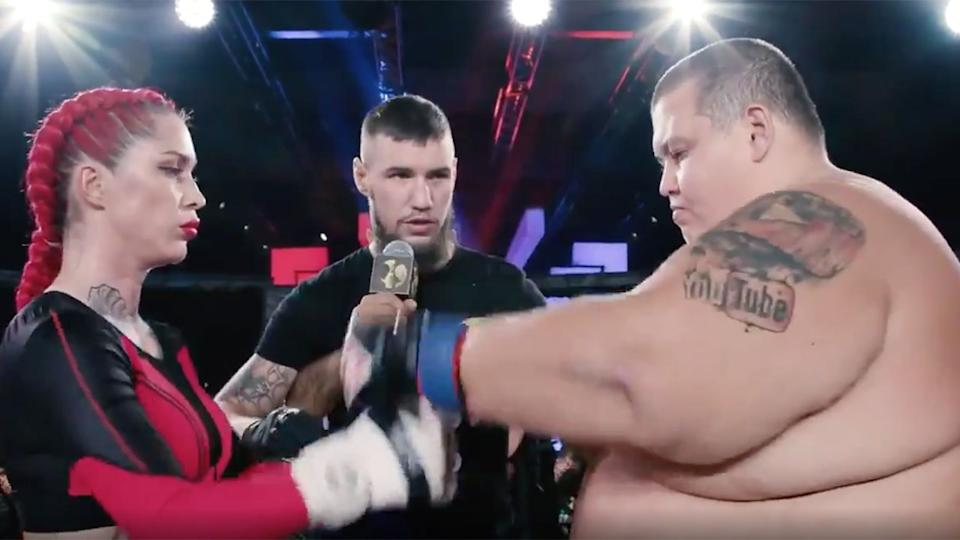 Seen here, Female MMA star Darina Mazdyuk and 240kg Youtuber Grigory Chistyakov touch gloves before their fight.
