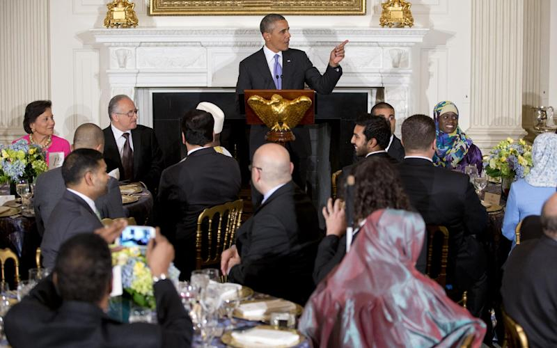 President Barack Obama speaks as he hosts an Iftar dinner celebrating Ramadan in the State Dining Room of the White House, Thursday, July 25, 2013, in Washington. (AP Photo/Carolyn Kaster)