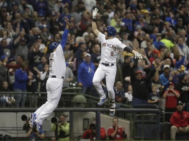 Milwaukee Brewers' Ryan Braun is congratulated by third base coach Ed Sedar after hitting a home run during the first inning of a baseball game against the Detroit Tigers Friday, Sept. 28, 2018, in Milwaukee. (AP Photo/Morry Gash)