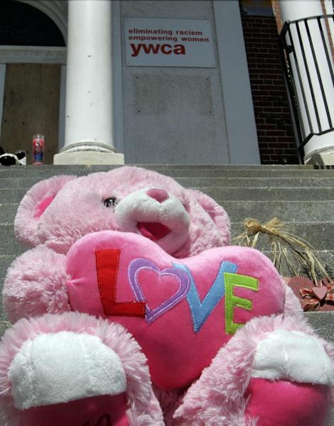 A stuffed bear sits on the steps of the YWCA Monday Aug. 12, 2013 in Manchester, N.H., a day after 9-year-old Joshua Savyon was shot and killed by his father. The New Hampshire attorney general's office said Muni Savyon, 54, was with his son during a supervised visitation Sunday when he took out a handgun and shot 9-year-old before shooting himself. (AP Photo/Jim Cole)