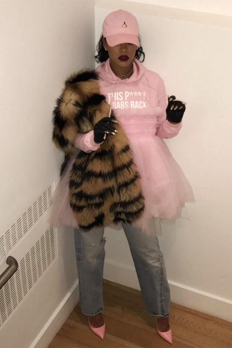 "<p>In a pink ""This P***y Grabs Back"" hoodie, tutu, patent leather pumps and dad hat, jeans, striped fur stole and fingerless gloves for the Women's March in New York.</p>"