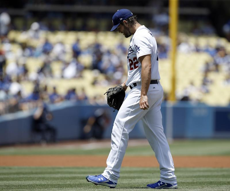 Los Angeles Dodgers starting pitcher Clayton Kershaw walks off the mound during the first inning of a baseball game against the Atlanta Braves in Los Angeles, Sunday, July 23, 2017.