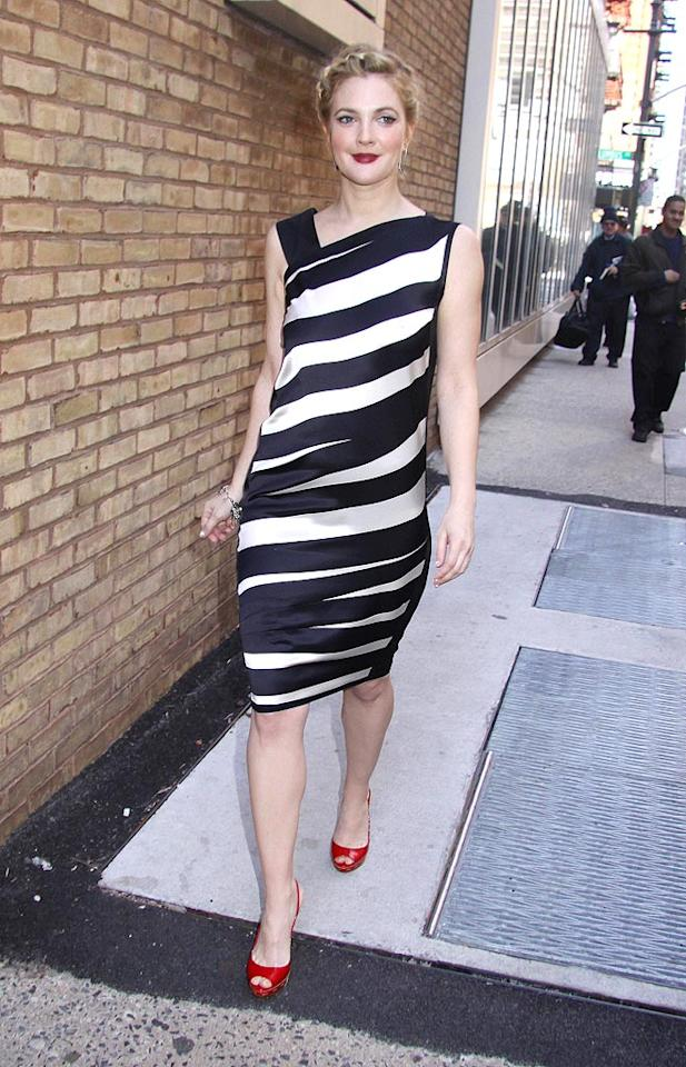 "Drew Barrymore looked better than ever as she left a taping of ""Live with Regis and Kelly"" in this black-and-white striped Narcisco Rodriguez asymmetrical dress, braided updo, ruby red lips, and matching $550 Miu Miu ""Whipstitch"" slingbacks. Jose Perez/<a href=""http://www.splashnewsonline.com"" target=""new"">Splash News</a> - April 13, 2009"