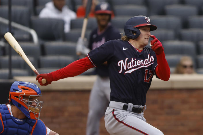 Washington Nationals' Andrew Stevenson follows through on an RBI-single during the fifth inning of a baseball game against the New York Mets, Saturday, April 24, 2021, in New York. (AP Photo/Jason DeCrow)