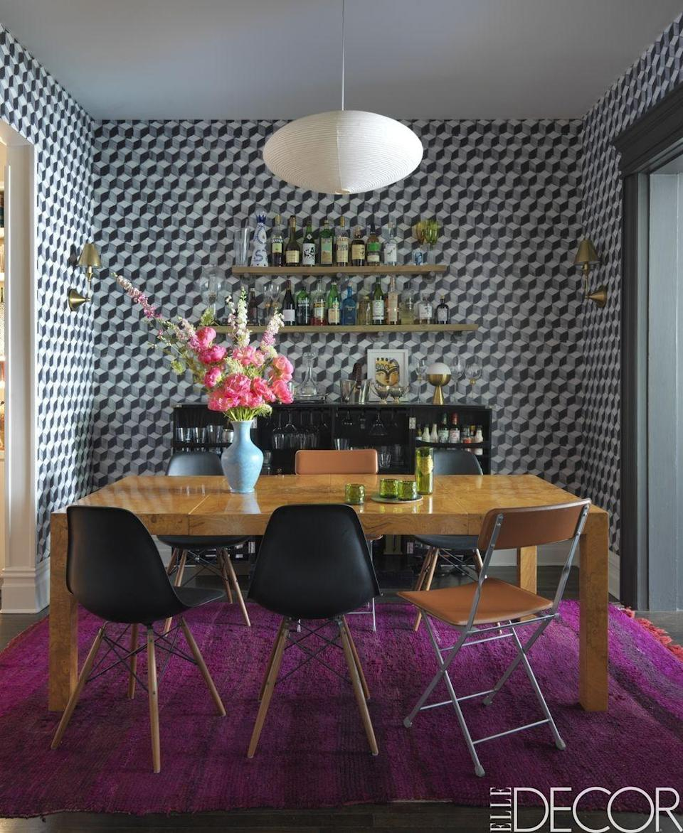 """<p>It's no surprise that wallpaper and textile maven Kate Reynolds's Brooklyn home is filled with extraordinary wallcoverings. The dining room features a fun geometric design by <a class=""""link rapid-noclick-resp"""" href=""""http://brianpaquetteinteriors.com/"""" rel=""""nofollow noopener"""" target=""""_blank"""" data-ylk=""""slk:Brian Paquette"""">Brian Paquette</a>, which is beautifully complemented by an authentic Moroccan rug. <em><br></em></p><p><em>Nantes Wallpaper, Inquire for Pricing</em><br><a class=""""link rapid-noclick-resp"""" href=""""http://brianpaquetteinteriors.com/products/nantes-wallpaper/"""" rel=""""nofollow noopener"""" target=""""_blank"""" data-ylk=""""slk:Shop the Look"""">Shop the Look</a></p>"""