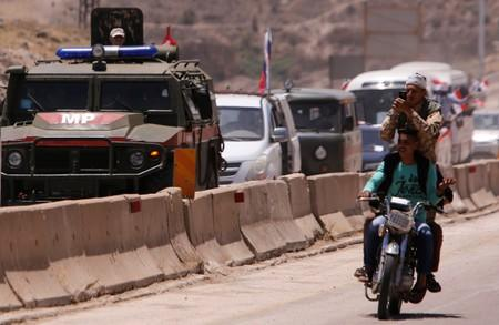 Syrian rebels say Moscow deploys ground forces in Idlib campaign