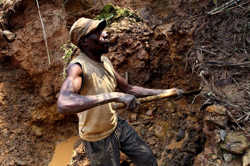 In this photo taken Aug. 17, 2012, one of the few remaining miners digs out soil which will later be filtered for traces of cassiterite, the major ore of tin, at Nyabibwe mine, in eastern Congo. Gold is now the primary source of income for armed groups in eastern Congo, and is ending up in jewelry stores across the world, according to a report published Thursday, Oct. 25, 2012, by the Enough Project. Following American legislation requiring companies to track the origin of the minerals they use, armed groups have been unable to profit from the exploitation of tin, tungsten, and tantalum, and have turned instead to gold, which is easier to smuggle across borders. Gold miners, like cassiterite miners, work in extreme conditions, with crude equipment such as pick-axes and shovels. (AP Photo/Marc Hofer)