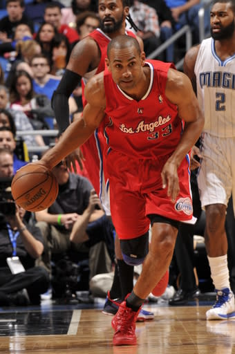 ORLANDO, FL - FEBRUARY 6: Grant Hill #33 of the Los Angeles Clippers dribbles the ball up the floor against the Orlando Magic during the game on February 6, 2013 at Amway Center in Orlando, Florida. (Photo by Fernando Medina/NBAE via Getty Images)