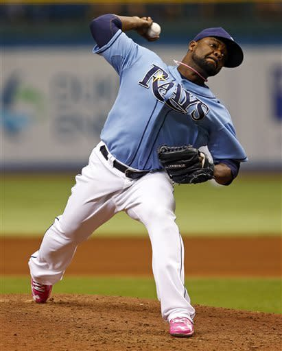Tampa Bay Rays relief pitcher Fernando Rodney throws during the ninth inning of a baseball game against the San Diego Padres, Sunday, May 12, 2013, in St. Petersburg, Fla. The Rays won 4-2. (AP Photo/Mike Carlson)