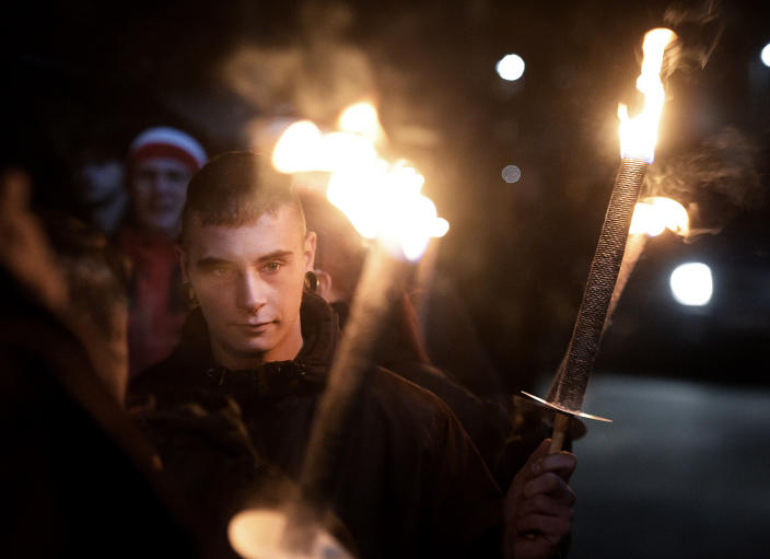 Demonstrators bear torches at a far-right rally in Jena, Germany, in 2016. (Photo: Jens Meyer/AP)