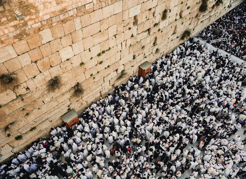 """Tens of thousands of Jewish pilgrims congregate at the Western Wall during Passover for the Birkat Kohanim, meaning """"Priestly Blessing""""."""