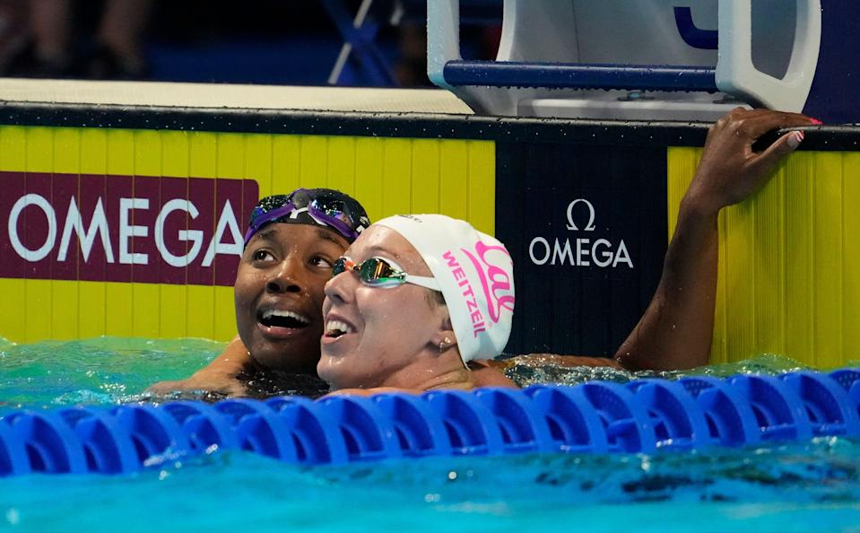 Simone Manuel (left) and Abbey Weitzeil (right) react after the women's 50 freestyle final during the U.S. Olympic Team Trials.