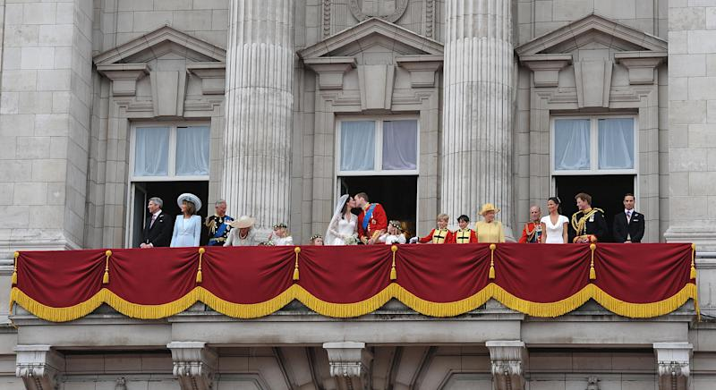 Kate Middleton's parents Michael and Carole Middleton (left) and members of the royal family join Prince William and his wife Kate Middleton, (centre) who has been given the title of The Duchess of Cambridge, as they kiss on the balcony of Buckingham Palace, London, following their wedding at Westminster Abbey. (Photo by John Stillwell/PA Images via Getty Images)