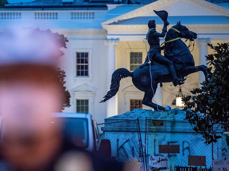 The equestrian statue of former US President General Andrew Jackson has ropes and chains still hanging, after protesters tried to topple it, at Lafayette square, in front of the White House, in Washington, DC on June 22, 2020: AFP via Getty Images