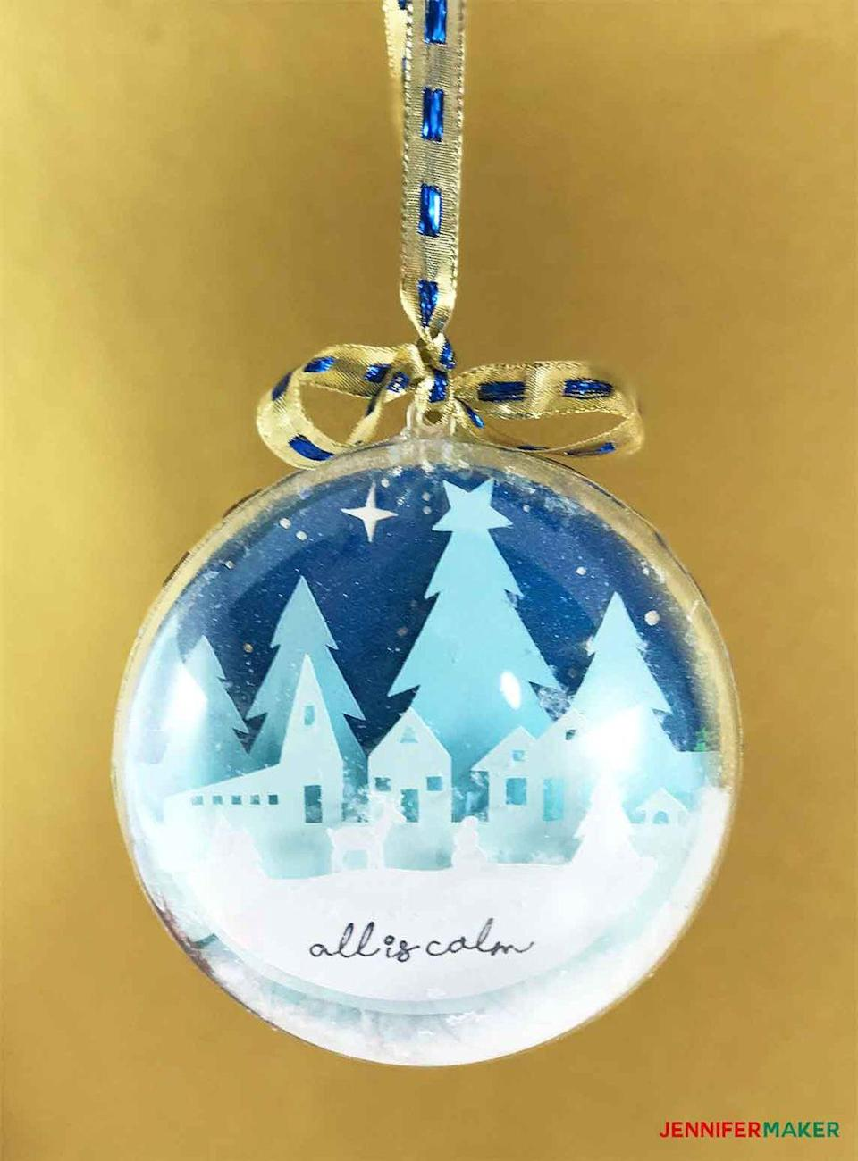 """<p>Use a clear fillable ornament to make a personalized snow globe. While this example uses small paper cutouts, you could just as easily use photos. </p><p><em>Get the tutorial at <a href=""""https://jennifermaker.com/diy-glitter-ball-ornament/"""" rel=""""nofollow noopener"""" target=""""_blank"""" data-ylk=""""slk:Jennifer Maker"""" class=""""link rapid-noclick-resp"""">Jennifer Maker</a>.</em></p><p><a class=""""link rapid-noclick-resp"""" href=""""https://www.amazon.com/Seekingtag-Clear-Fillable-Ornaments-Ball/dp/B00SXUQN3W/?tag=syn-yahoo-20&ascsubtag=%5Bartid%7C10072.g.34443405%5Bsrc%7Cyahoo-us"""" rel=""""nofollow noopener"""" target=""""_blank"""" data-ylk=""""slk:SHOP CLEAR ORNAMENTS"""">SHOP CLEAR ORNAMENTS</a></p>"""