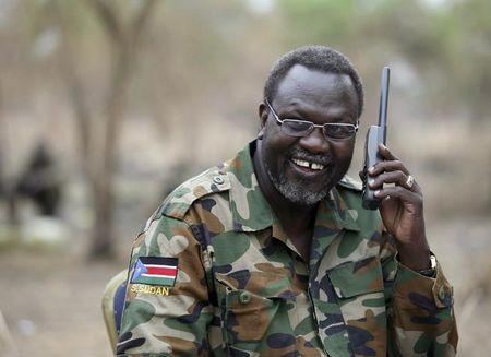 File photo: A file photo shows South Sudan's rebel leader Riek Machar talking on the phone in his field office in a rebel-controlled territory in Jonglei State