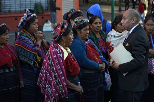 """Aldo Davila (R) of the left-wing Winaq party, Guatemala's first openly gay and HIV positive congressman, told AFP that outgoing president Morales """"was always on the side of corruption and impunity"""""""