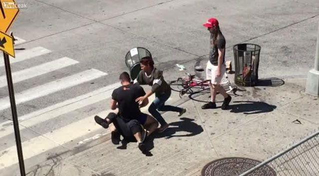 An onlooker records the moment three people are caught in a Manhattan street brawl in what appears to be a road rage incident. Source: LiveLeak