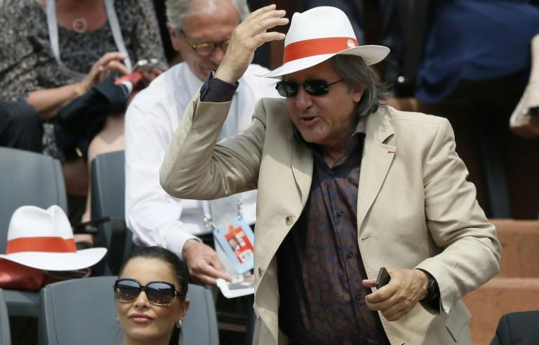 Romanian Fed Cup captain Ilie Nastase (C) has been suspended by the International Tennis Federation (ITF) over foul-mouthed and abusive behaviour during the tie against Britain
