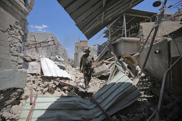 <p>A member of the Iraqi anti-terrorism forces (CTS) walks amidst the debris in the Old City of Mosul on June 22, 2017, during the ongoing offensive by Iraqi forces to retake the last district still held by the Islamic State (IS) group. (Photo: Ahmad al-Rubaye/AFP/Getty Images) </p>