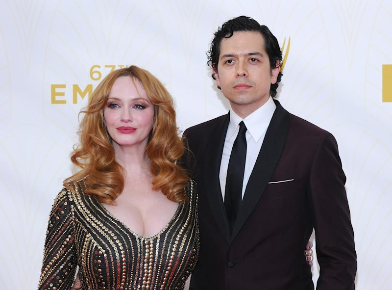 Christina Hendricks, left, and Geoffrey Arend arrive at the 67th Primetime Emmy Awards on Sunday, Sept. 20, 2015, at the Microsoft Theater in Los Angeles. (Photo by Vince Bucci/Invision for the Television Academy/AP Images)