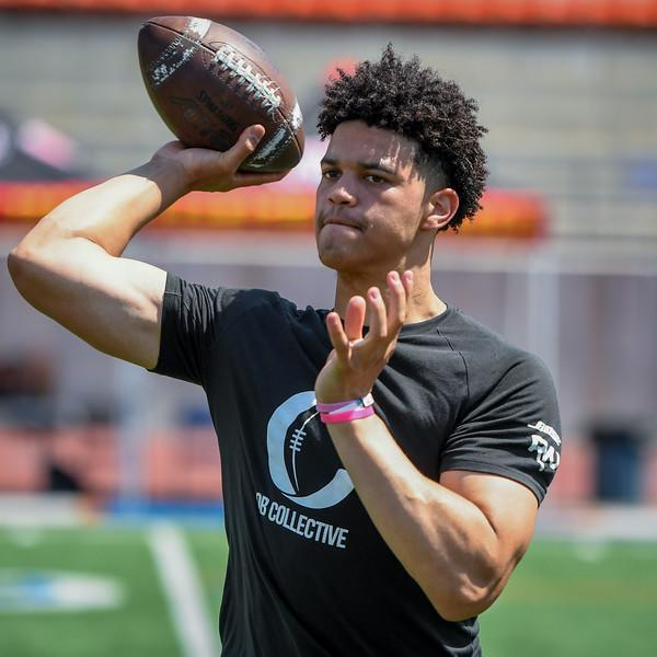 "<a class=""link rapid-noclick-resp"" href=""/ncaaf/players/305336/"" data-ylk=""slk:Caleb Williams"">Caleb Williams</a> throws during the QB Collective camp in July. Williams is one of the top recruits in the Class of 2021. (Credit: QB Collective)"