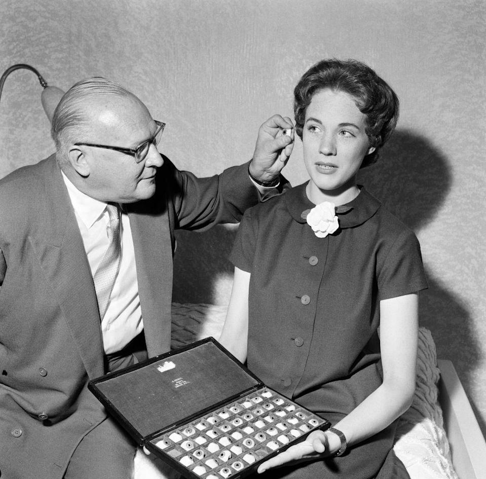 <p>Ocularist Eric Greiner is seen here choosing the perfect set of eyes for Julie Andrews' wax figure, which was put in the actresses gallery at Madame Tussauds. </p>