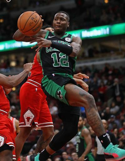 CHICAGO, ILLINOIS - DECEMBER 08: Terry Rozier #12 of the Boston Celtics passes off against the Chicago Bulls at United Center on December 08, 2018 in Chicago, Illinois. The Celtics defeated the Bulls 133-77. (Photo by Jonathan Daniel/Getty Images)