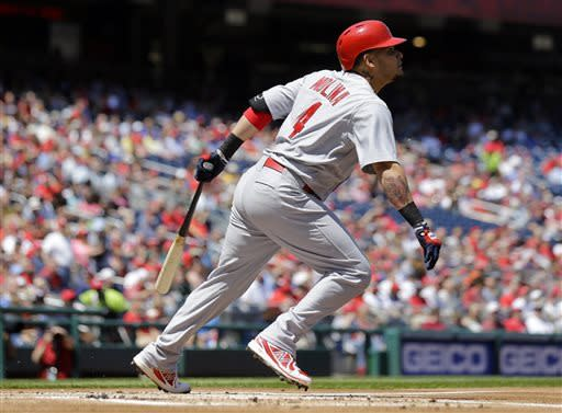 St. Louis Cardinals catcher Yadier Molina watches his two-RBI single during the first inning of a baseball game against the Washington Nationals at Nationals Park Wednesday, April 24, 2013, in Washington. (AP Photo/Alex Brandon)