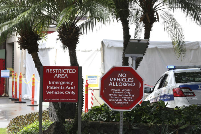 A tent is seen outside the emergency room at The Queen's Medical Center in Honolulu, Tuesday, Aug. 24, 2021. Hawaii was once seen as a beacon of safety during the pandemic because of stringent travel and quarantine restrictions and overall vaccine acceptance that made it one of the most inoculated states in the country. But the highly contagious delta variant exploited weaknesses as residents let down their guard and attended family gatherings after months of restrictions and vaccine hesitancy lingered in some Hawaiian communities.(AP Photo/Caleb Jones)