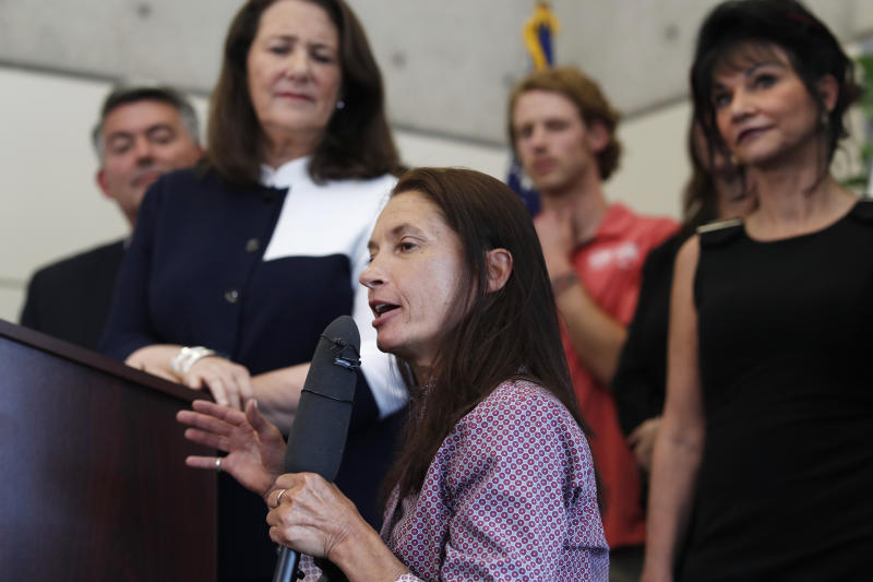 Sarah Will, front, of Arvada, Colo., who is a 12-time gold medalist in skiing in the Paralympics, makes a point as, from back left, U.S. Sen. Cory Gardner, R-Colo., U.S. Rep. Diana DeGette, D-Colo., and Judge Rosemarie Aquilina listen during a news conference to announce a plan to introduce legislation aimed at reforming the U.S. Olympic Committee Monday, June 17, 2019, in Denver. Nearly a dozen Olympic athletes were on hand to lend their support to the measure, which DeGette plans to introduce this week. (AP Photo/David Zalubowski)