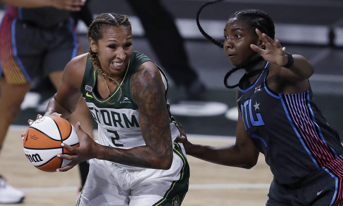 Seattle Storm center Mercedes Russell (2) drives as Atlanta Dream forward Elizabeth Williams, right, defends during the second half of a WNBA basketball game Friday, June 11, 2021, in College Park, Ga. (AP Photo/Ben Margot)