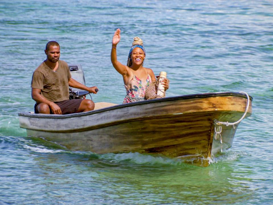 Lauren-Ashley Beck riding a smaller boat and waving on survivor