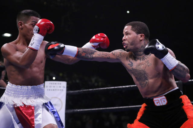 FILE - In this July 27, 2019, file photo, Gervonta Davis, right, throws a punch at Ricardo Nunez during the first round of their super featherweight boxing championship bout in Baltimore. Eager to take his career to a higher level, Davis will move up to fight Cubas Yuriorkis Gamboa for the WBAs secondary lightweight title. (AP Photo/Julio Cortez, File)