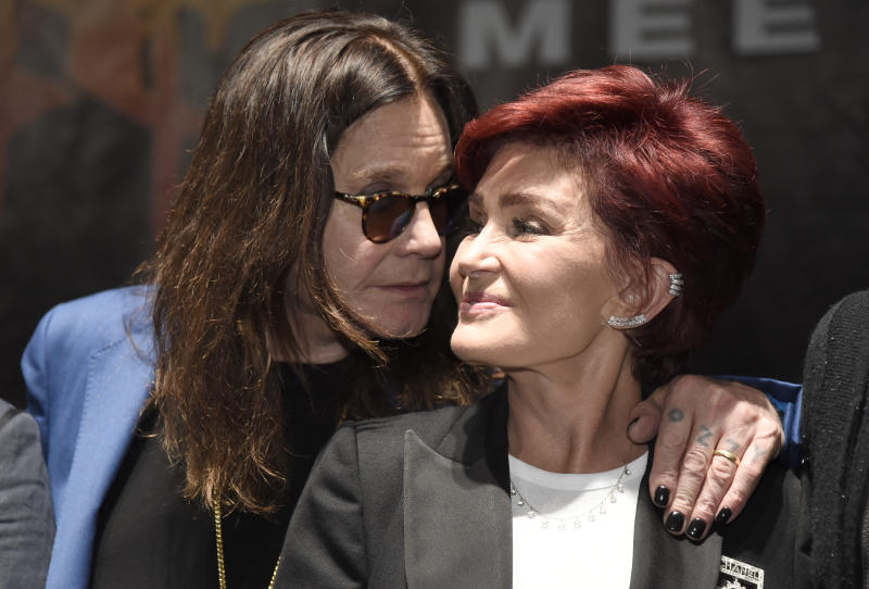 "Ozzy Osbourne, left, joins his wife Sharon onstage during the ""Ozzfest Meets Knotfest"" news conference at the Hollywood Palladium on Thursday, May 12, 2016, in Los Angeles. The ""Ozzfest Meets Knotfest"" multi-stage camping festival on Sept. 24-25 at the San Manuel Amphitheater and Festival Grounds in San Bernardino, Calif. was announced at the news conference. (Photo by Chris Pizzello/Invision/AP)"