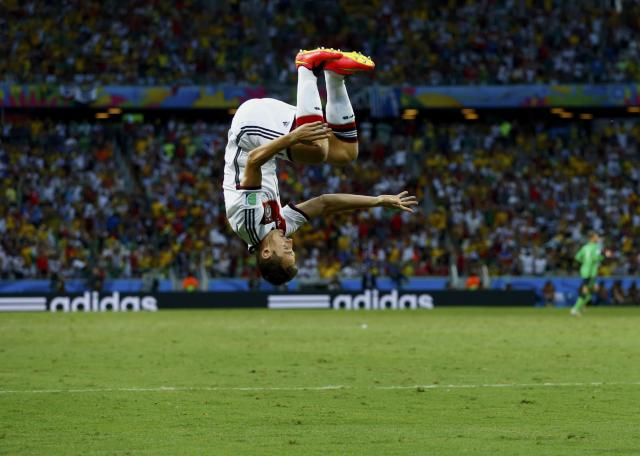 Germany's Miroslav Klose celebrates after scoring against Ghana during their 2014 World Cup Group G soccer match at the Castelao arena in Fortaleza June 21, 2014. REUTERS/Eddie Keogh (BRAZIL - Tags: SPORT SOCCER WORLD CUP) TOPCUP