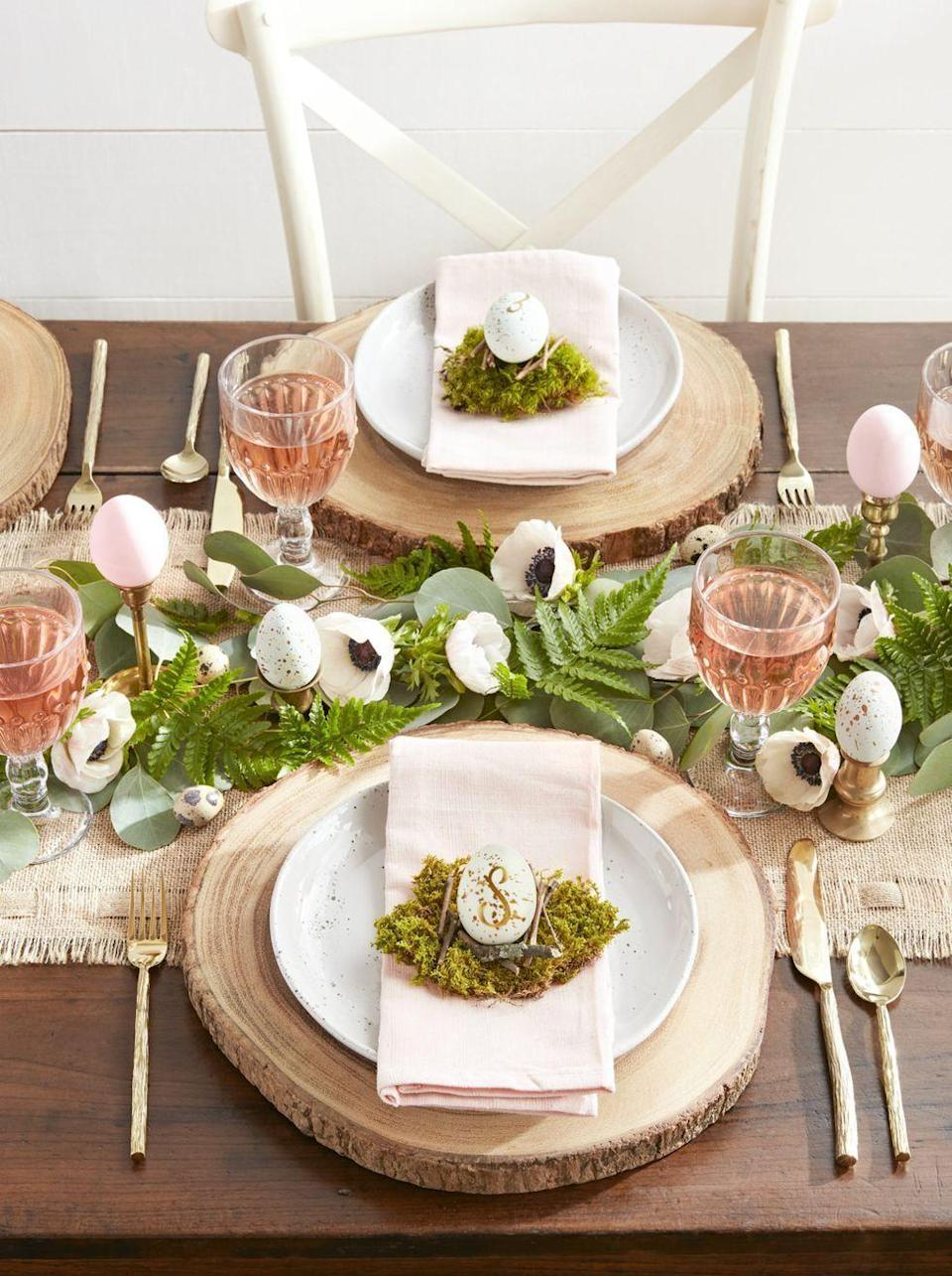 """<p>Save a trip to the store by making your own place cards for the big Easter feast this year.</p><p><strong><em>Get the tutorial at <a href=""""https://www.countryliving.com/diy-crafts/how-to/g524/easter-fun-stuff-0406/?slide=11"""" rel=""""nofollow noopener"""" target=""""_blank"""" data-ylk=""""slk:Country Living"""" class=""""link rapid-noclick-resp"""">Country Living</a>.</em></strong></p><p><strong><a class=""""link rapid-noclick-resp"""" href=""""https://www.amazon.com/DecoArt-Americana-Acrylic-2-Ounce-Lavender/dp/B000XZVON4/ref=dp_prsubs_1?pd_rd_i=B000XZVON4&psc=1&tag=syn-yahoo-20&ascsubtag=%5Bartid%7C10070.g.1751%5Bsrc%7Cyahoo-us"""" rel=""""nofollow noopener"""" target=""""_blank"""" data-ylk=""""slk:SHOP PAINT"""">SHOP PAINT</a></strong></p>"""