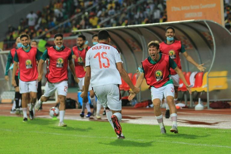 Soufiane Bouftini (C) celebrates scoring the first goal for Morocco in a 4-0 African Nations Championship sem-final victory over hosts Cameroon.