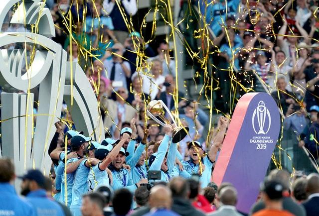 England players lift the trophy as they celebrate winning the ICC World Cup (John Walton/PA)