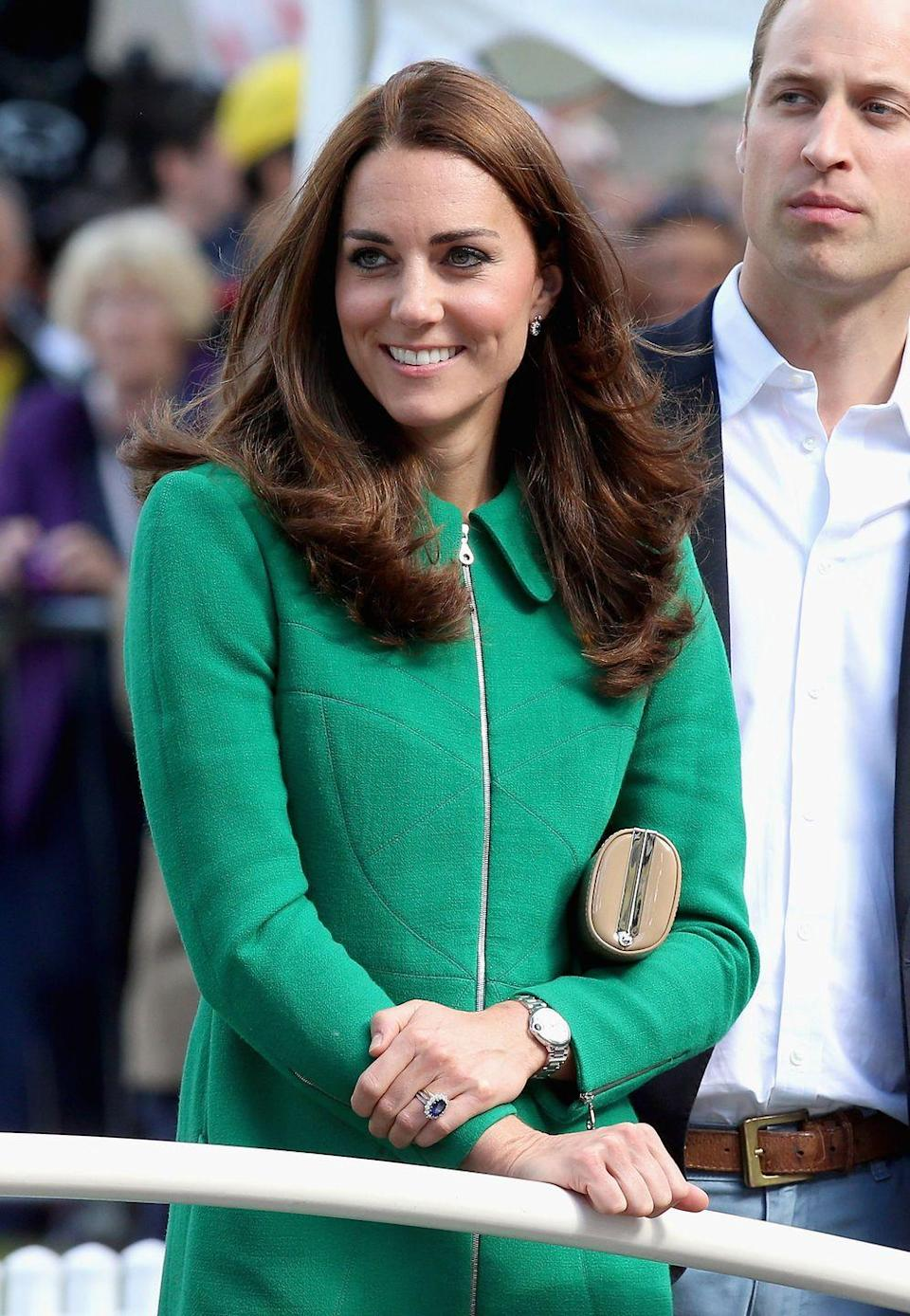 <p>It's really hard to tell that she's at a different event but, believe it! (It's the hair.) Kate joined Will and Harry on the sidelines at the finish line of Stage 1 of the Tour De France in the U.K. </p>