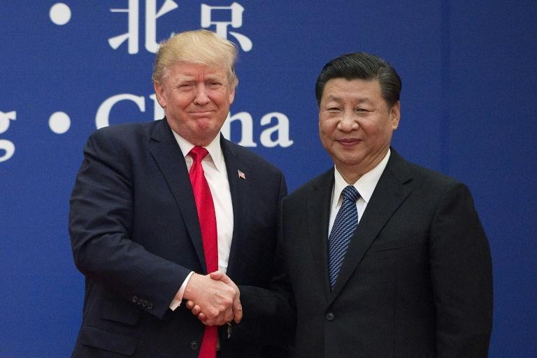 US President Donald Trump (L) and China's President Xi Jinping -- seen here in November 2017 -- made a good start to their relationship, but it faltered as a result of the coronavirus pandemic and trade disputes