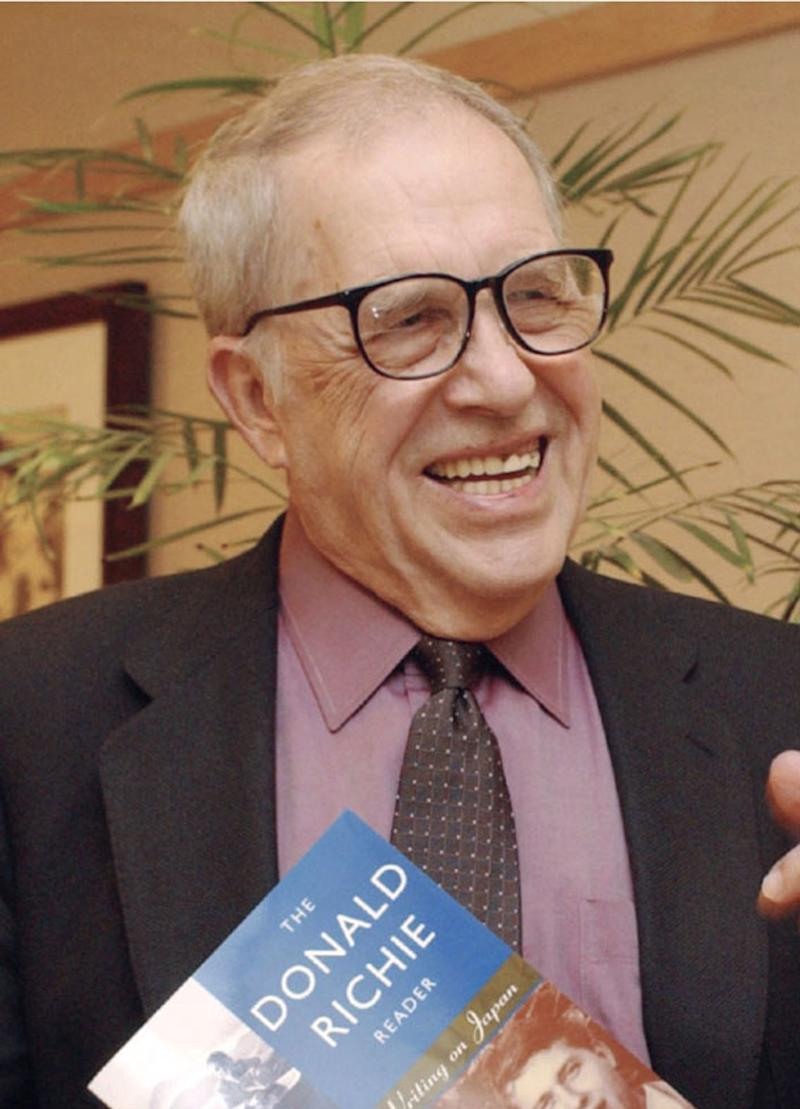 This 2002 photo shows Donald Richie, a Tokyo-based expert on Japanese cinema.  Richie, who wrote dozens of books and articles about the country's people and culture, has died at age 88. The Japan Times newspaper, where Richie was a longtime contributor, said he died Tuesday, Feb. 19, 2013,  in Tokyo. It gave no other details. Richie reviewed Japanese films and the arts for the newspaper for more than 50 years. (AP Photo/Kyodo News) JAPAN OUT, MANDATORY CREDIT, NO LICENSING IN CHINA, HONG KONG, JAPAN, SOUTH KOREA AND FRANCE
