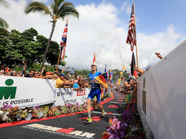 """<p>KAILUA-KONA, HAWAII – The Ironman World Championship is magical. This year, in both the men's and women's races, it was also record-setting.</p><p>Germany's Patrick Lange finished the 2.4-mile swim, 112-mile bike and 26.2-mile marathon in eight hours, one minute, 40 seconds on Saturday. Not only did Lange become world champion, he now holds the reigns to the overall course record, previously set by Australia's Craig Alexander (8:03:56) in 2011. Consider this victory an encore for Lange, who only last year finished third in his Ironman World Championship pro debut, beating the 27-year old marathon course record set by the U.S.'s Mark Allen in 1989 with his 2:39:45 run.</p><p>""""I'm overwhelmed and this is my life dream coming true,"""" said Lange, 31. """"[During] the swim there was a lot of fighting, but I executed the swim like I wanted to.""""</p><p>At the 21.6-mile mark of the marathon, the Frankfurt native closed the gap on Canada's Lionel Sanders to one minute and 37 seconds and continued to chug, whizzing past Sanders at 23.4 miles. Lange never looked back and absorbed the energy that surrounds the notorious Kailua-Kona community at the famous Ali'i Drive finish.</p><p>""""The bike was an interesting race dynamic with a lot of on and off,"""" Lange said. """"It was really hard to stay on the bike [because of] conditions with the crosswinds. Then, I started the run feeling a little bit weak—I felt like it was a really hot day. At the aid station my body was a little overheating. But I found a good rhythm.""""</p><p>Sanders, who finished second in 8:04:07, began the marathon crushing sub-six-minute miles during the initial trio and held the lead for a majority of race. Well, that's until the Lange hammer struck in a painful way.</p><p>""""This guy's a freaking animal,"""" Sanders said jokingly of Lange. """"It was a very humbling experience when I tried to go with him for a second … and it lasted about a second. This was the best fight I've ever been involved in.""""</p><p>Climbing to the podi"""