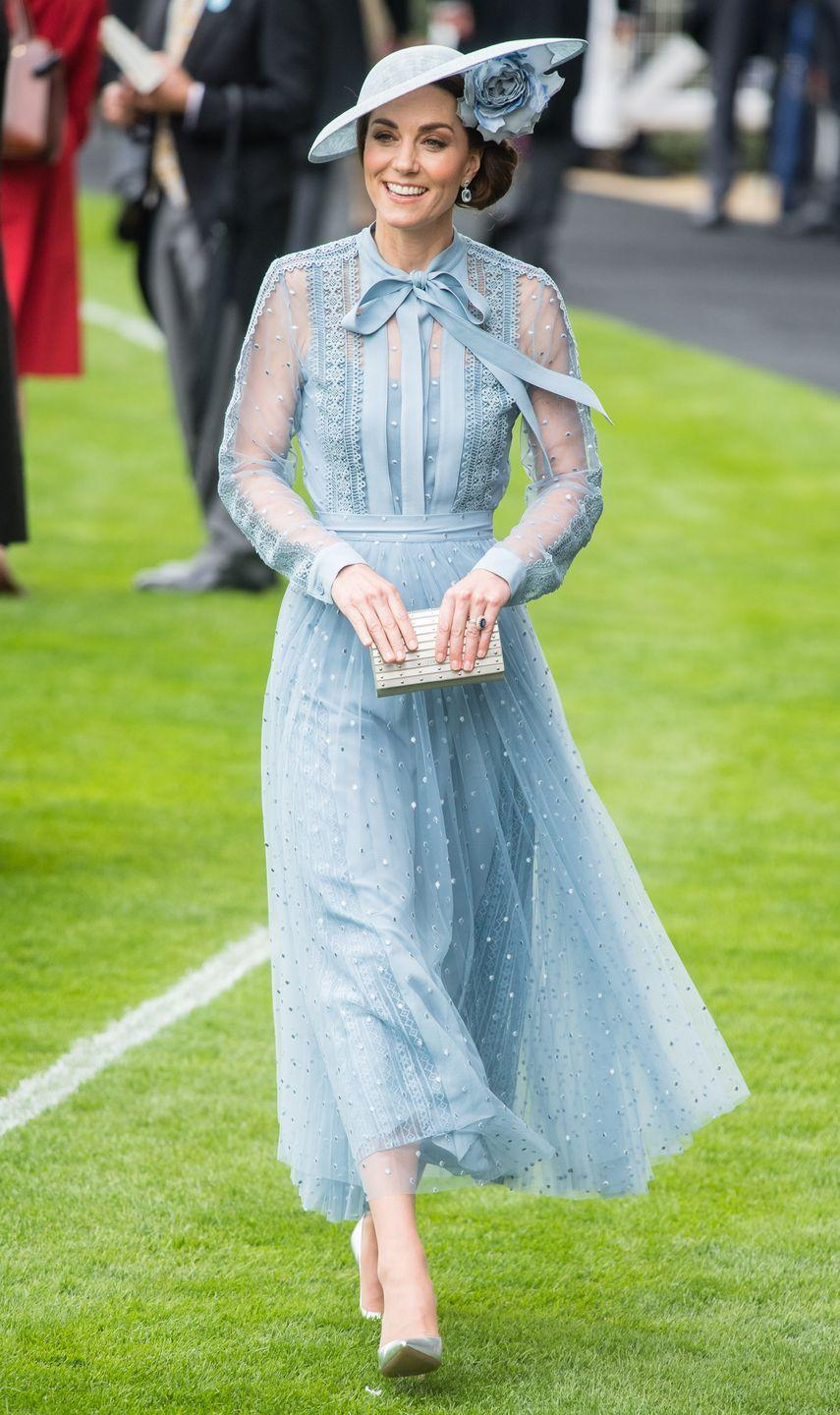 """<p><a href=""""https://www.townandcountrymag.com/style/fashion-trends/a28072096/kate-middleton-elie-saab-blue-dress-royal-ascot-day-1-2019/"""" rel=""""nofollow noopener"""" target=""""_blank"""" data-ylk=""""slk:Kate chose an Elie Saab dress and matching pale blue hat for the first day of Royal Ascot"""" class=""""link rapid-noclick-resp"""">Kate chose an Elie Saab dress and matching pale blue hat for the first day of Royal Ascot</a>. Silver heels and a metallic clutch finished off the look.</p>"""