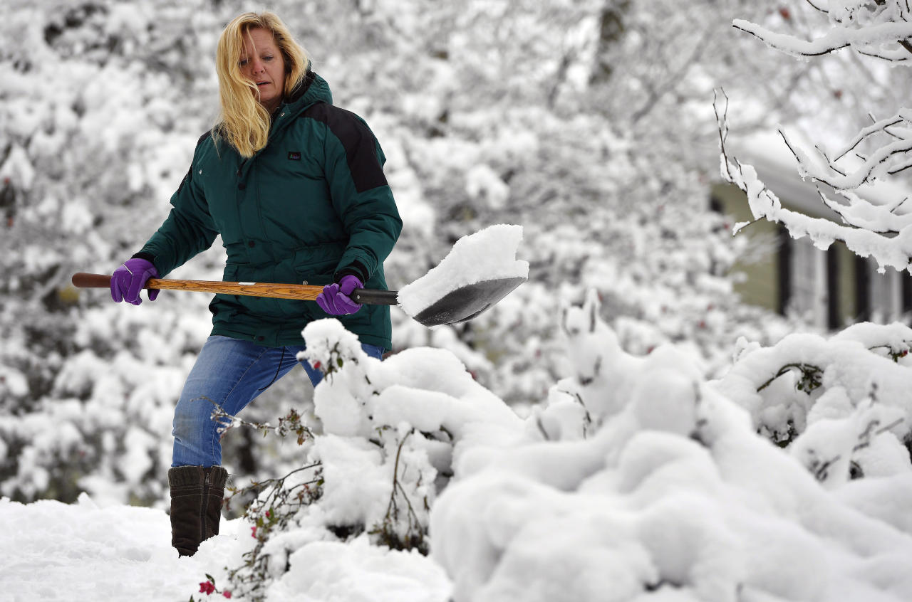 <p>Laura Washington shovels her walk after a heavy snow, Saturday, Dec. 9, 2017, in Kennesaw, Ga. The frigid temperatures behind a cold front combined with moisture off the Gulf of Mexico to bring unusual wintry weather to parts of the South. (Photo: Mike Stewart/AP) </p>