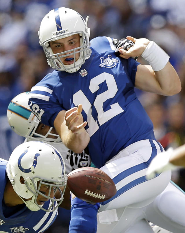 Indianapolis Colts' Andrew Luck (12) fumbles the ball as he is sacked by Miami Dolphins' Derrick Shelby during the first half an NFL football game on Sunday, Sept. 15, 2013, in Indianapolis. The Colts recovered the ball. (AP Photo/Michael Conroy)