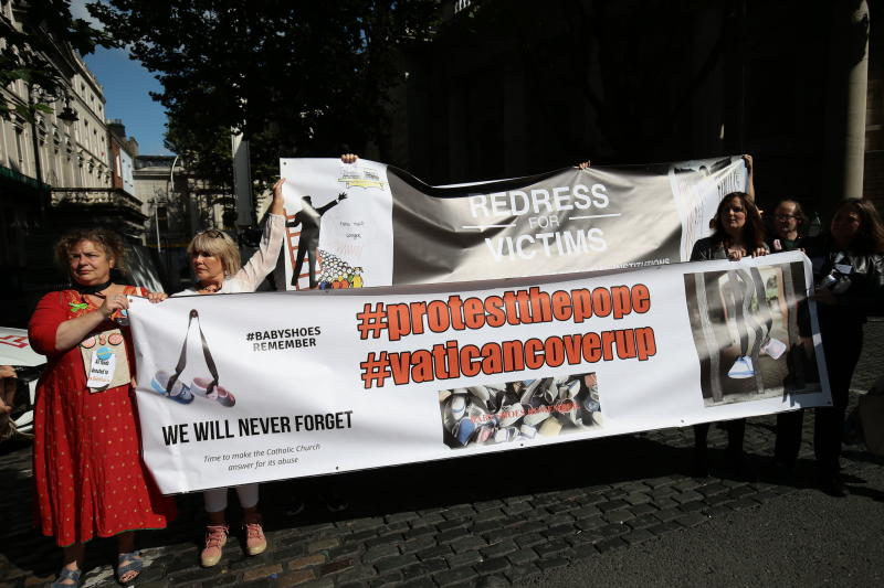Protesters call for redress for victims of Catholic Church clerical sex abuses, during a protest they held during Pope Francis' visit to Ireland, in Dublin, Ireland, Saturday, Aug. 25, 2018. The pontiff is traveling to Ireland for a two-day visit on the occasion of the 2018 World Meeting of Families. (Aaron Chown//PA via AP)