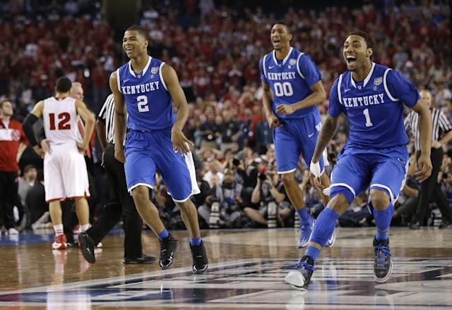 Kentucky's Aaron Harrison (2), Marcus Lee (00) and James Young, right, celebrate at the end of their 74-73 victory over Wisconsin in an NCAA Final Four tournament college basketball semifinal game Saturday, April 5, 2014, in Arlington, Texas. (AP Photo/David J. Phillip)